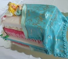 Sleeping Beauty cake! Could also probably be modified with more layers to be a Princess & the Pea cake.