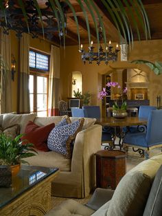 The furnishings are colorful while the walls are a muted burnt terra cotta color.