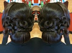 black low chignon with rosettes wedding updo