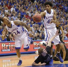 Kansas' Kevin Young and Travis Releford try and advance the ball against Kansas State's Will Spradling during the first half on Monday night at Allen Fieldhouse in Lawrence. (Feb. 11, 2013)