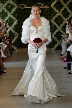 I wanted a fur jacket or shal for my special day! love this. 2013 Oscar de la Renta Bridal Couture Collection