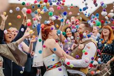 Faith and Matt's summer wedding was full of handmade details and was inspired by their love of colour and Jurassic Park! They had lots of multi-coloured pom poms such as on the bride's Crown & Glory veil and they had their guests throwing them instead of confetti!