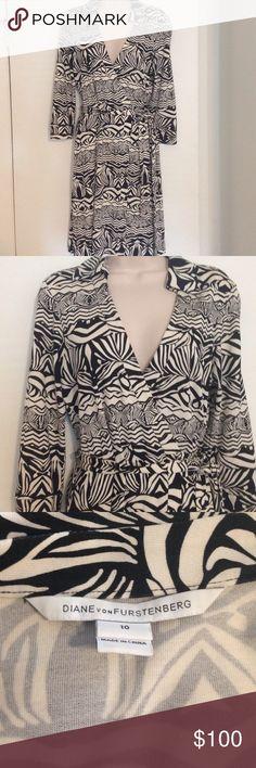 Authentic Diane von  Furstenberg Wrap Dress Black and cream printed wrap dress with collar.100% silk. 3/4 length sleeves. Diane von Furstenberg Dresses Midi