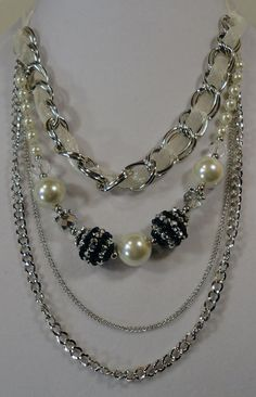 Adjustable Sheer Cream Ribbon Bride Necklace with Silver Chain, Cream Glass Pearls, Crystal Beads, Silver and Black Glass Beads. $30.00, via Etsy.