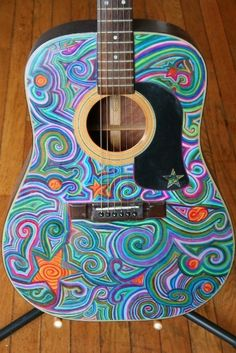 I've always wanted to make a guitar look artistic.  Paint it or color it.  So cool.