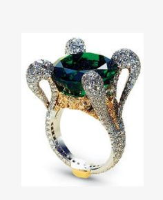 Colombian emerald and diamond ring, not sure of the hallmark but it is quite fabulous~