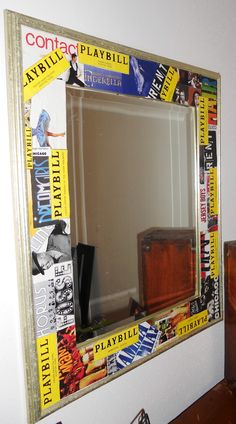 Mirror, using playbills as a frame ** I'm sure I can find something to decoupage like this...don't have a mirror. I love the playbills. Would also look amazing if it was all black with the yellow playbill.**
