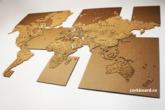 World Cork Map. 10 mm cork on adhesive film 3M It easy to place this cork map on the wall. Cork map has side special sticky layer 3M. Cork map consist of 70 cork stickers(continents and islands). Set cardboard templates for correct installation are applied. Each element and its place in the template are numbered. The size of the parcel: 1050*850*100 mm. #corkboard #corkmap #corkworldmap #map #design #walldecor #ecointerior #worldmap # #corkboardru Cork World Map, Cork Map, Map Design, Travel Design, Travel Maps, Home Wall Decor, Diy Videos, How To Apply, Stickers