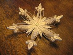 Quilled filigree paper snowflake. $27.00, via Etsy.