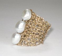 Hand knit ring with triple freshwater pearl by SusanaBernardini, $60.00