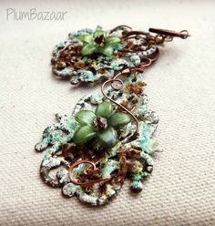 Wire wrapped vintage inspired filigree earrings, enamel with verdigris and rusty patina, hand painted flower by PlumBazaar on Etsy https://www.etsy.com/listing/204988503/wire-wrapped-vintage-inspired-filigree