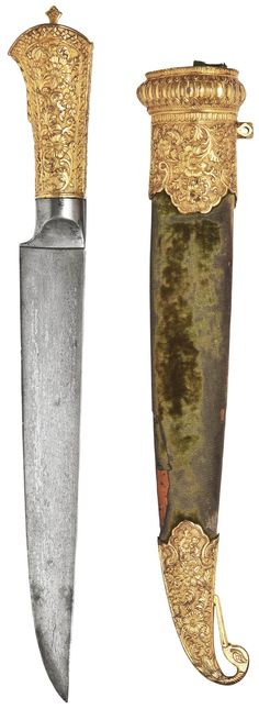 Indo-Persian kard dagger, Persian (Safavid) watered steel blade, 17th to 18th century, Indian (Kutch) mounts, 19th century, straight single edged blade tapering towards the point, the gilt-copper hilt and scabbard's mounts with deeply carved floral decoration, the sheath covered with green velvet, 14 3/8in. (36.5cm.) long.