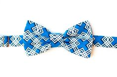 A blue modern cross with white bow tie! A popular plus sign design in a vibrant royal blue. A great blue wedding theme accessory. Those groomsmen would look so hipster and dapper in this one of a kind design!