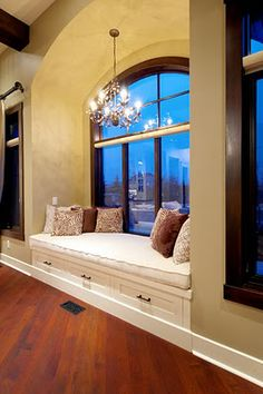 Love that window seat chandellier!