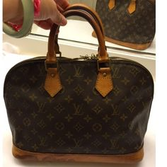Louis Vuitton Alma MM hand bag MAKE AN OFFER Authentic , made in France , date code : VI 0924 , leather handles and bottom have turned honey patina and have some water marks , inside has marks as shown , 13.4x9, no rips or holes , zipper works , awesome find ; established seller , NO TRADES, serious reasonable offers only Louis Vuitton Bags