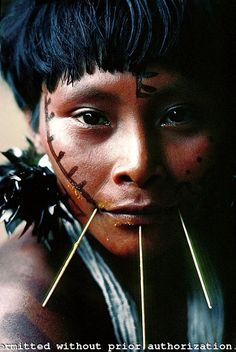 Brazil. Amazon rain forest. Yanomami Indian woman. Her mouth is smeared with soup she just ingested from a bid calabash.