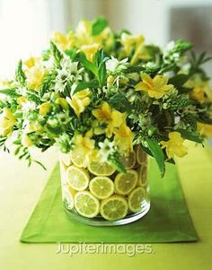 I'm creating centerpieces for my friend's wedding. All it is are clear vases with a flower arrangement. How can I dress up the vase so you don't s Fruit Centerpieces, Wedding Centerpieces, Wedding Decorations, Centrepieces, Lime Centerpiece, Fresh Flowers, Beautiful Flowers, Diy Flowers, Lemon Flowers