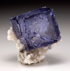 Fluorite with Dolomite   #Geology #GeologyPage #Mineral Location: Elmwood Mine Smith Co. Tennessee US Size: 5.0 x 4.5 x 3.5 cm (miniature) Gemmy purple color zoned fluorite crystal 2.8 cm on edge set on a crystallized dolomite matrix. Photo Copyright Weinrich Minerals Geology Page www.geologypage.com