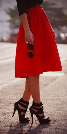 I love the length of this skirt. And the heals look like they could be comfortable :) Pop of red
