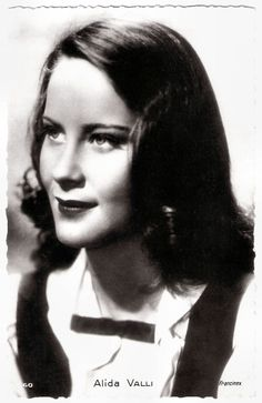 Alida Valli. French postcard by Edit. Chantal, Rueil, no. 60. Photo: Francinex. Strikingly beautiful actress Alida Valli (1921-2006) was Italy's Sweetheart of the early 1940s. She fascinated audiences not only with her flawless porcelain face, her dark, voluptuous hair and her green, expressive eyes, but also with her ability to simultaneously hide and reveal a character's thoughts and emotions. In a career that spanned seven decades, she appeared in more than 110 films including such…
