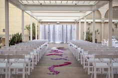 Sachie & Jason's beautiful ceremony on our Garden Terrace, accented with Origami on the backdrop hand made by the bride herself and purple aisle petals! #sandiegoweddings #outdoorweddings #sandiegoceremony #leafweddingphotography