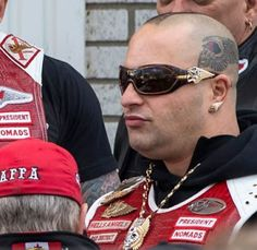 "The Stopru is reporting that ""The president of the Hells Angels Nomads Ontario, Martin Bernatchez, was the victim of an assassination. Chopper Motorcycle, Motorcycle Clubs, Motorcycle Style, Hells Angels, Bald Head Tattoo, Motorcycle Boots Outfit, Gangster Party, Der Club, Trendy Girl"