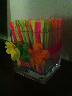 Pixy stix in square jar for a candy buffet table at a luau party