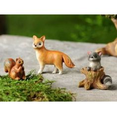 Woodland Animals www.teeliesfairygarden.com These charming woodland animals would make the fairies jump with glee! This squirrel, fox, and raccoon on a tree stump would be great friends with the enchanted folks in your garden! #fairyanimals