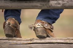 Boots spurs Boots and Spurs. Cowboy boots and spurs resting on a split rail fence , Boots and Spurs. Cowboy boots and spurs resting on a split rail fence , Spurs Western, Cowboy Spurs, Rodeo Cowboys, Cowboy Gear, Cowboy And Cowgirl, Western Boots, Cowboy Hats, Real Cowboys, Western Art