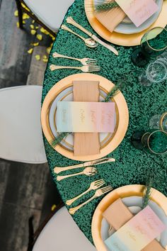 gold and green table decor with rainbow menu