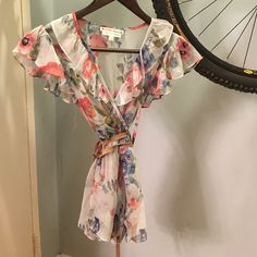 Nanette Lepore, bergdorf Goodman size 0 Gorgeous silk flower shirt with shell buttons and tie at neck.  Belt not included Nanette Lepore Tops Blouses