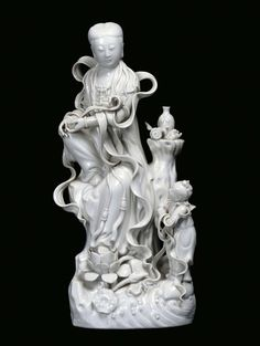 A Blanc de Chine porcelain Guanyin with child, China, 20th century