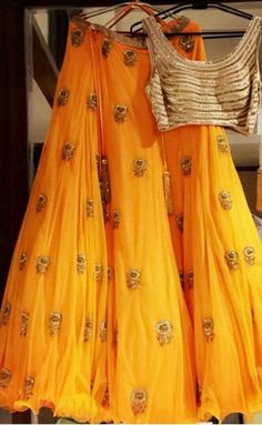 Get yourself dressed up with the latest lehenga designs online. Explore the collection that HappyShappy have. Select your favourite from the wide range of lehenga designs Bridal Outfits, Indian Wedding Outfits, Indian Outfits, Wedding Attire, Yellow Lehenga, Red Lehenga, Lehenga Choli, Bridal Lehenga, Party Wear Lehenga