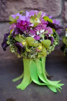 Gorgeous bouquet with green cymbidium orchids and purple cattelya orchids