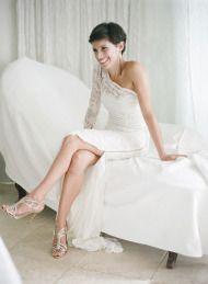 Asymmetrical long sleeve wedding dress. Love the lace! Modern Clifftop Ibiza Wedding