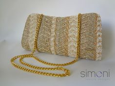 Image of Hand-woven Gold magic clutch with clip