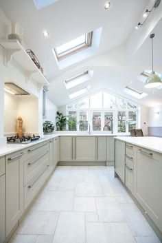 A single-storey kitchen extension by L&E (Lofts and Extensions) in Teddington - don't move extend. Pitched Roof Extension, Kitchen Design Ideas, Kitchen Extension, Skylights, Green Pendant Lights