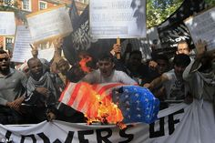 """Anger: The demonstrators shouted 'burn burn USA' as the American flag went up in flames, in response to a recent movie which portrayed the prophet Muhammad as a womanizer and child abuser.   It is a scary image to see our flag burned in London, England.  Hollywood has dragged my precious Lord and savior through the mud """"The Last Temptation of Christ"""" movie was a desecration, but no one was killed.  My God said for me to forgive my enemies and love those who persecute me.."""