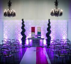 Dramatic backdrops to a unique altar piece, offset with gorgeous tuxedo chairs.