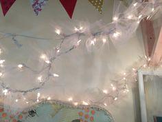Sheer fabric tied around Christmas lights.