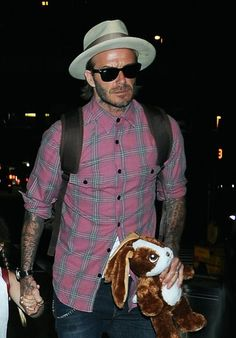 David Beckham Photos Photos - David Beckham and his children departing on a flight at LAX airport in Los Angeles, California on April 17, 2017. - David Beckham Spotted At LAX