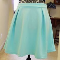 Pleated Scuba Skater Skirt Super fun skirt from Charlotte Russe in good condition, flaws are pictured. Perfect to wear with a crop top or tucked in blouse. Size large fits a 10/12. Length is mid thigh. Charlotte Russe Skirts Circle & Skater
