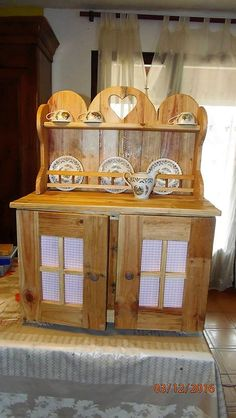 If you are searching how to make a pallet wood Dining Room Hutch on your own here are a few simple and easy steps. The first step is to cut square pieces of cloth and staple them onto pieces of squared pallet wood structures. The next step is to cut pallet wood boards into rectangular shapes and to paste them onto a different patterned wooden board. Now, you need to make this structure stand on its own. For this you need to make the rectangle as the base of the table. Next up, cover the…