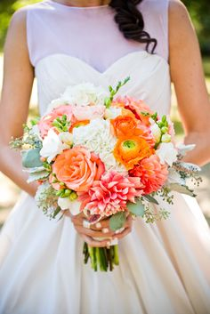 Garden roses, dahlias, ranunculuses and hydrangeas in shades of coral and white made up Danielle's cheerful bouquet.