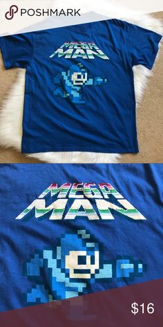 Capcom Mega Man Graphic T-Shirt XL Capcom Mega Man T-Shirt. Size men's XL. Tag has been cut out. Shirt is in excellent condition - no flaws. Measurements flat Pit to pit Length Shirts Tees - Short Sleeve Mega Man, Tee Shirts, Tees, 8 Bit, Pixel Art, Flaws, Fashion Design, Fashion Trends, Man Shop