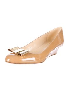 Tan patent leather Kate Spade New York round-toe wedges with gold-tone accents.
