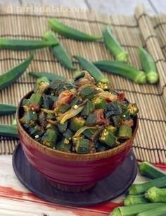 Bhindi also called okra or ladies finger has acquired an exotic image in the west, but in fact this is one of the most commonly consumed vegetables in India. The Punjabis love their bhindi and eat it in every for, fried curries and stuffed. Here this delicious vegetable has been deep fried, making it crisp and crunchy and then tossed in a semi dry masala before serving. Serve sukhi bhindi with some Punjabi dal and rice.
