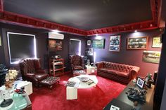 An eccentric Gothic themed smokers/games room. I know this is not everyone's cup of tea but I really appreciate the individuality of this room and the dark theme to it. Everywhere you look is inundated with quality upon quality.... and this is just one room to the other 14 rooms! Want to see more?  go to http://www.ryderrealestate.com.au/real-estate/property/742337/for-sale/house/vic/kurunjang-3337/2-highfield-way/
