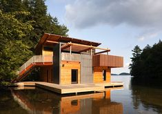 Christopher Simmonds' Beautiful Sustainable Boathouse Sits Peacefully on the Waters of Muskoka Lake Muskoka Lakes Boathouse – Inhabitat - Sustainable Design Innovation, Eco Architecture, Green Building Haus Am See, Floating House, Floating Boat, Rustic Design, Modern Design, Cabana, Custom Homes, Modern Architecture, House Design