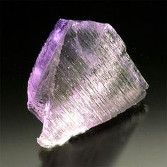 Oceanview Kunzite,  Above, showing the width of the blade, and below, showing the deep lilac color down the C axis. (Photo: Jason Stephenson)